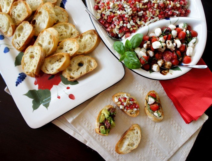A display of holiday party food on plates on a table