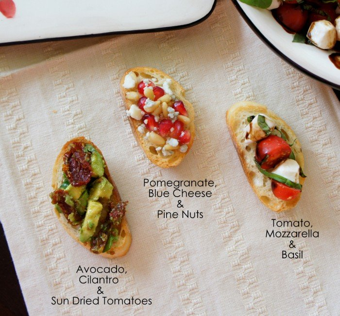 Three little toasts on a table with different toppers