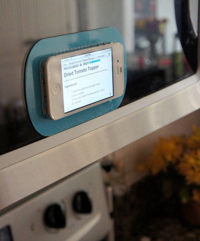 A phone sticking to a Stick UM on a microwave