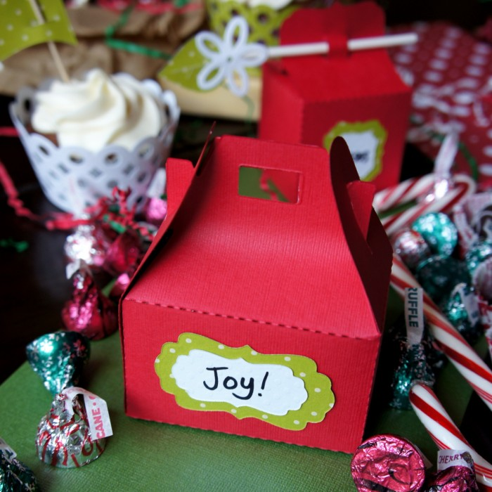 A close up of a gift box next to other holiday colored food
