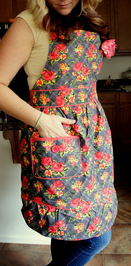 A close up of a woman with her hand in the pocket of a Jesse Steele Apron