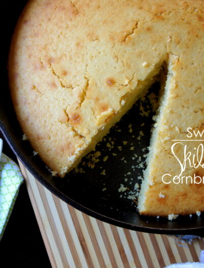 A close up of a pan of Sweet Skillet Cornbread with a slice removed