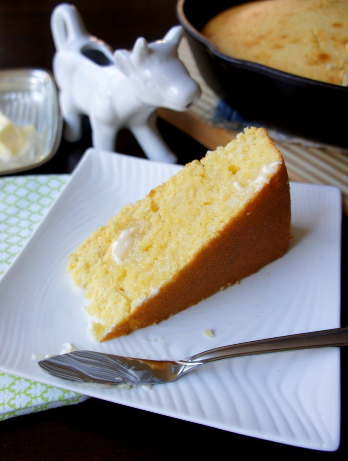 A slice of Sweet Skillet Cornbread on a plate