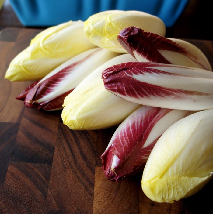 A close up of a pile of endives