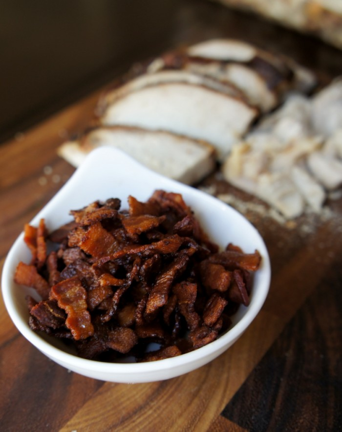 A close up of a bowl of cooked chopped bacon