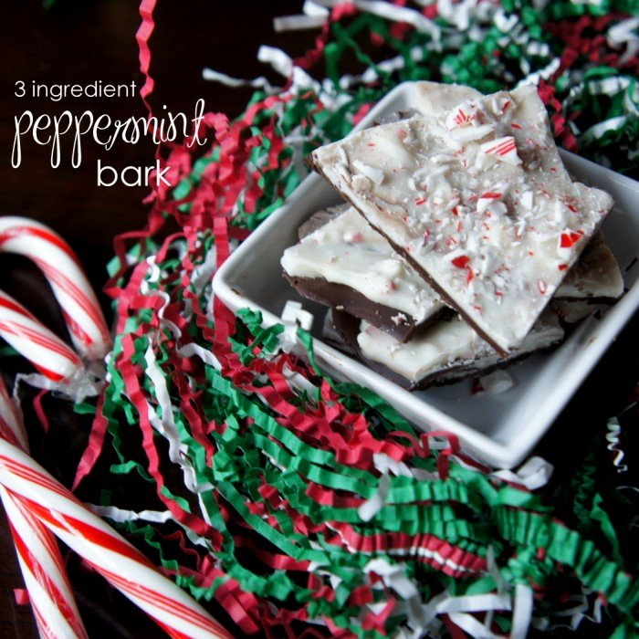 Peppermint bark pieces in a bowl on a table with red and green decor