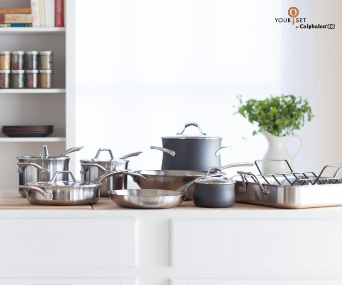 A kitchen counter with a set of pans on it