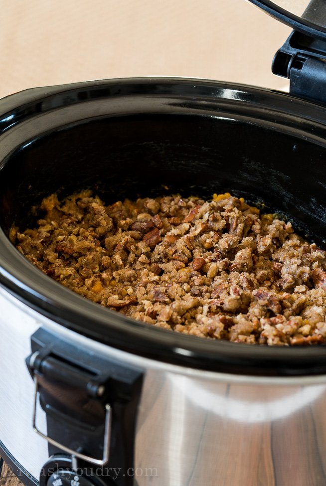 Sprinkle the brown sugar pecan topping over the mashed sweet potatoes and let cook for another 2 hours.