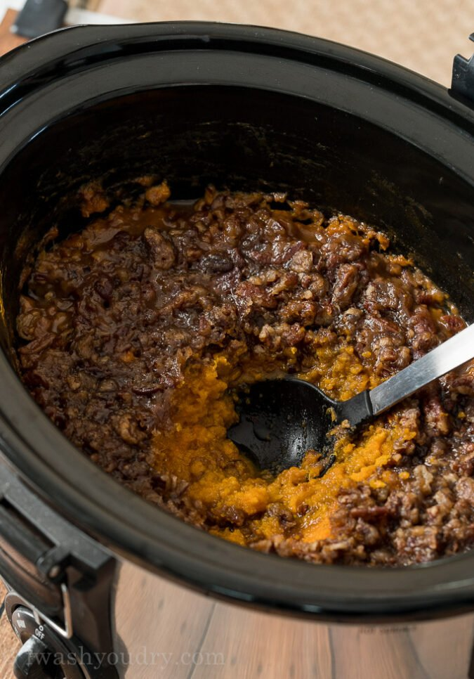 Once the casserole is ready, let it sit for a few minutes before digging in! This Slow Cooker Sweet Potato Casserole makes the perfect holiday side dish!
