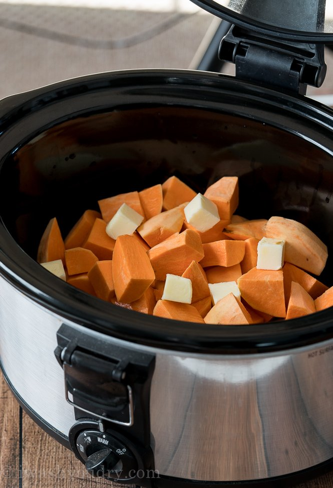 Add your chopped sweet potatoes, chicken broth and butter to your slow cooker.