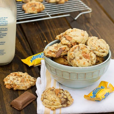 A bowl of cookies on a table that are made with Butterfinger Halloween Candy