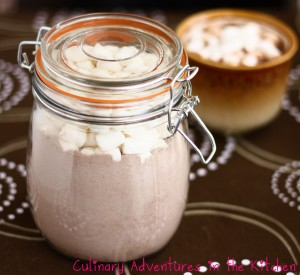 A jar of chocolate powder topped with mini marshmallows