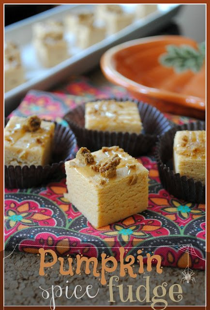 Squares of pumpkin fudge displayed in brown candy wrappers