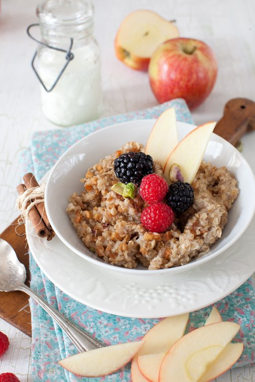 A bowl of oatmeal topped with fruit
