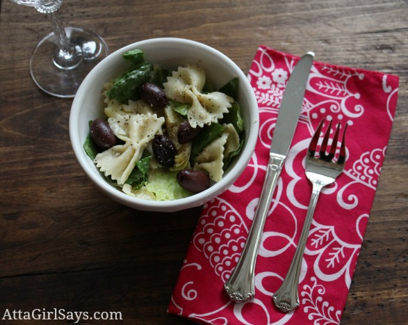 A bowl with artichokes and bowtie pasta