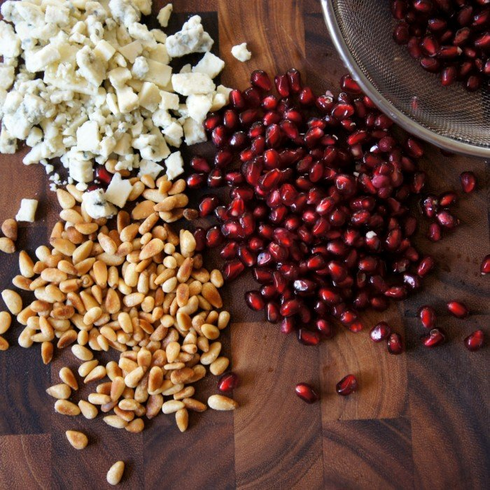 Pomegranate arils with pine nuts and blue cheese crumbles.