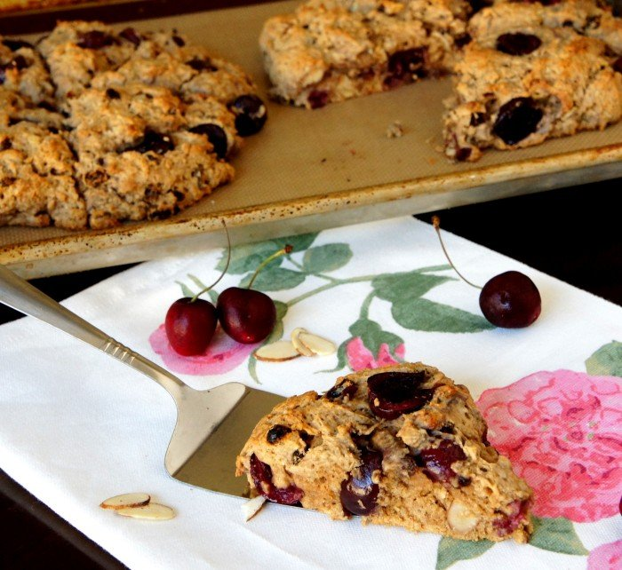 A close up of slice of Cherry Almond Scone