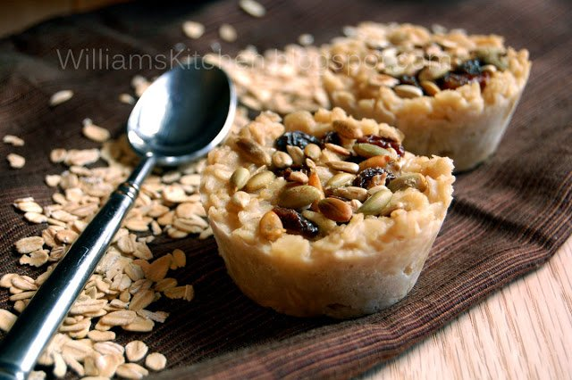 A close up of a mini tart on a wooden surface with oats around it