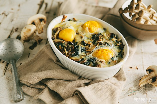 A bowl of mushroom spinach baked eggs