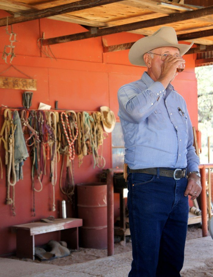 A rancher drinking a beverage
