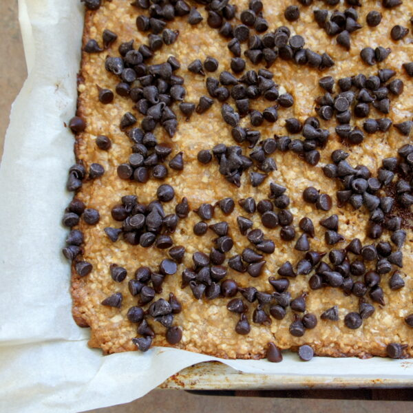 A pan with baked Oat\'s n Toffee topped with chocolate chips