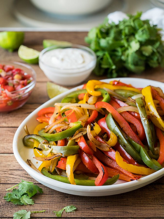 Charred sweet peppers make the best addition to steak fajitas