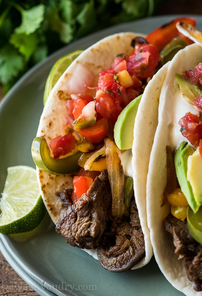 These quick and easy Steak Fajitas are sure to become your new favorite weeknight dinner! YUM!