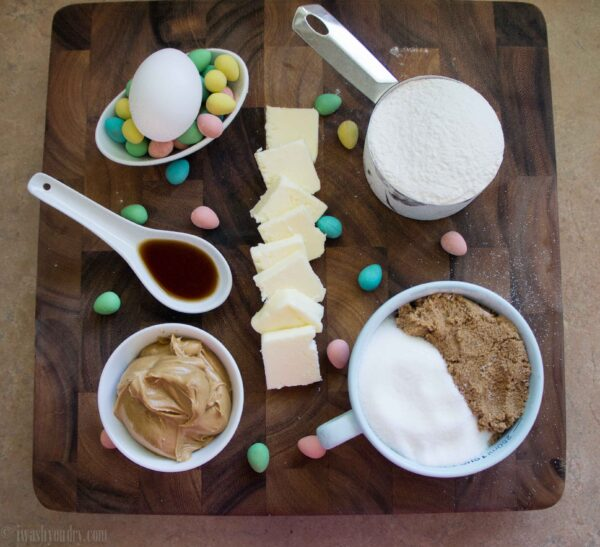 A display of ingredients needed in measuring cups for Peanut Butter and Chocolate Egg Blondies