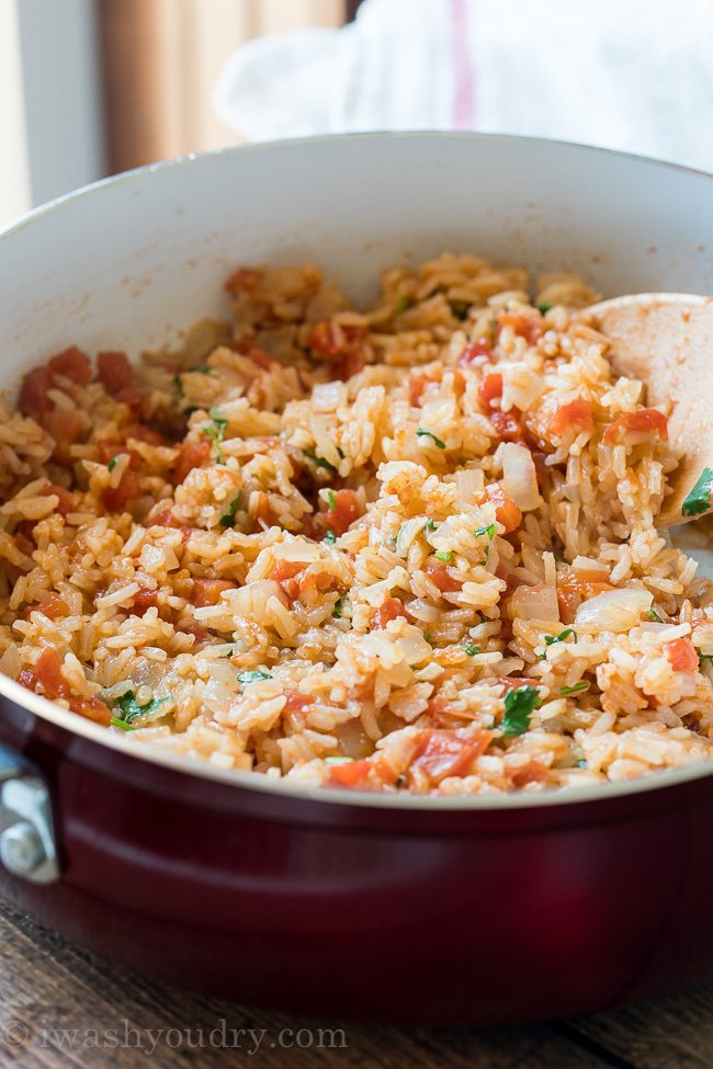 This quick and easy Mexican Rice recipe is always a favorite for taco night or enchilada night!