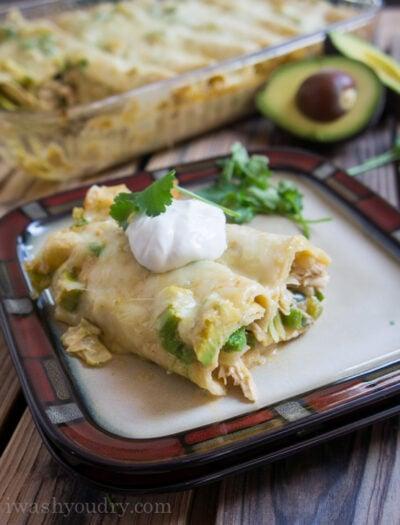 Creamy White Chicken and Avocado Enchiladas