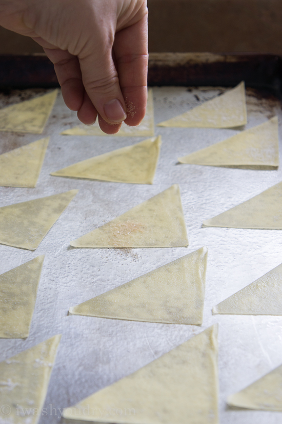 A pan with triangle slices of dough on it