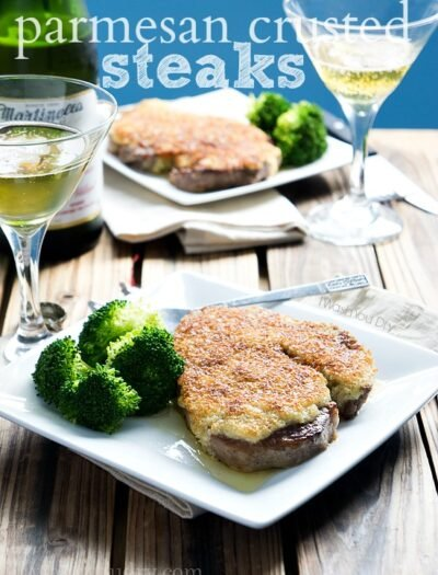 Two Plates on a table with Parmesan Crusted Steak and a side of broccoli