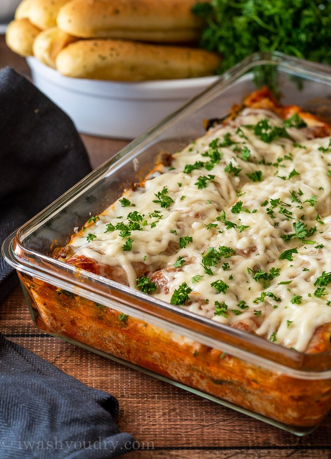 This Classic Lasagna Recipe is filled with Italian sausage, spinach and a creamy ricotta cheese filling. It's a classic Italian dish that's perfect for Sunday supper and even great for freezing!