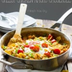 One Skillet Cheesy Chicken Nacho Casserole, ready in just 20 minutes for a quick and easy weeknight dinner!