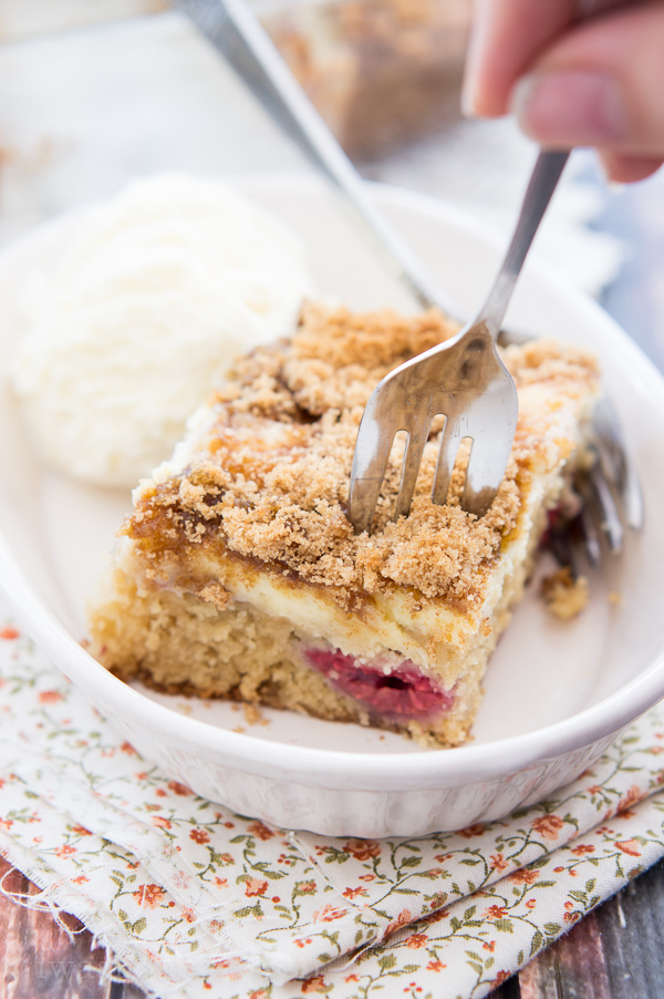 This Cheesecake Swirled Brown Sugar Cake is devilishly moist, filled with plump raspberries and blackberries, then topped with a creamy cheesecake swirl and a crisp brown sugar crumble.