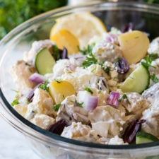 This Creamy Greek Potato Salad is a deliciously bright and fresh twist to a classic potato salad recipe!