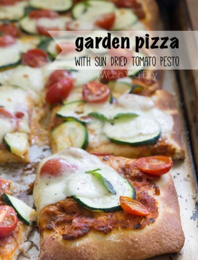 """Pizza on a pan titled, """"Garden Pizza with Sun Dried Tomato Pesto"""""""