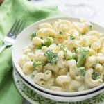 This Creamy Alfredo Broccoli Mac and Cheese is a quick 20 minute dinner recipe that's perfect for an easy weeknight meal! The whole family loves this one!