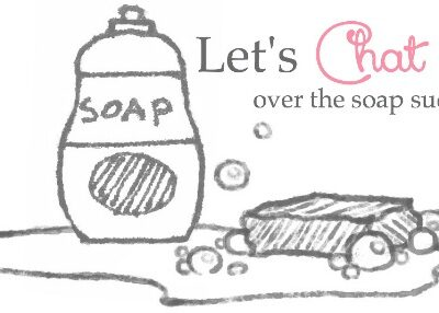 """A sketch of a soap bottle and a bar of soap with """"Let's Chat over the soap suds"""" written above them"""