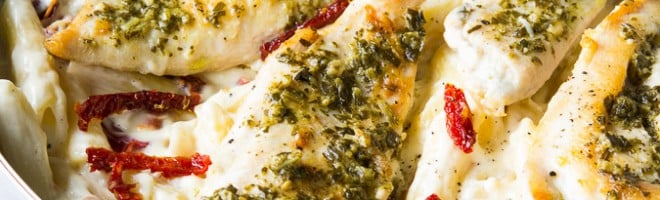 Basil Pesto Chicken with Alfredo Penne and Sun Dried Tomatoes! This is a one skillet dish that's ready in about 20 minutes!! My family absolutely loved this one!