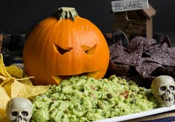 Frightfully Delicious Pumpkin Guacamole! Such a fun way to serve the guacamole for Halloween!