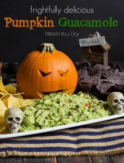 Frightfully Delicious Pumpkin Guacamole! Such a fun way to serve the guacamole for Halloween!