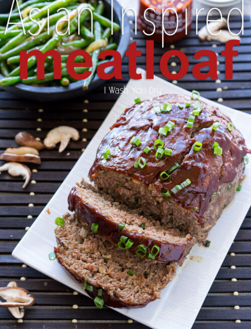 A meatloaf on a white serving plate with 2 slices made in it.