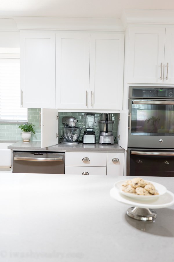 Store your small appliances on your countertop for easy access, but hide them behind cabinets to keep counters clean.