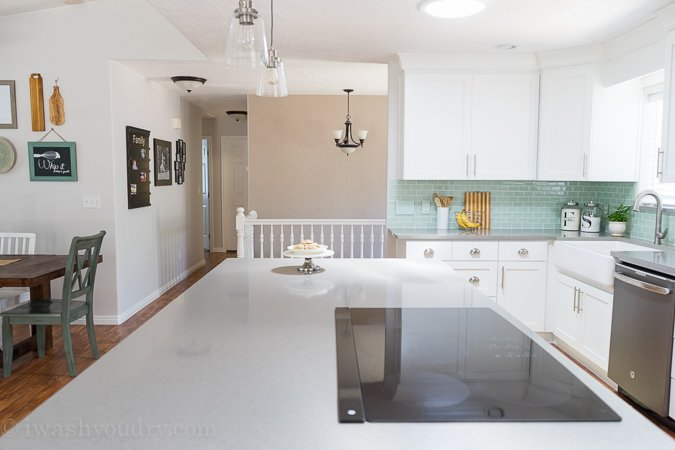 Love the bright white shaker style cabinets with the Quartz grey countertops. It looks like concrete, but much more durable and easy to take care of.
