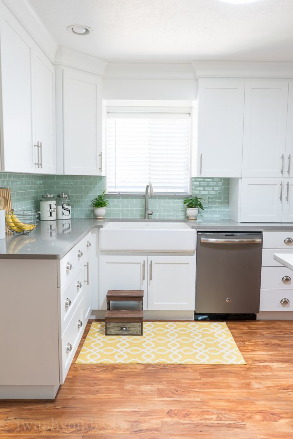 Gorgeous white cast-iron enameled, apron front, farm house sink by Kohler. Love the backsplash tile here as well. Stunning!