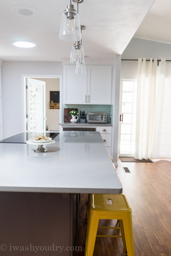 Love this Kitchen transformation! The pendant lights are simply gorgeous!