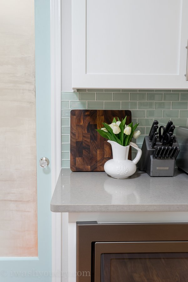 Gorgeous backsplash tile in Arctic Ice. Love the white shaker style cabinets and Slate appliances by GE. Dream kitchen!!