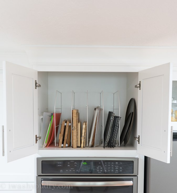 Use a rack to store cutting boards, cookie sheets and pizza pans to easily access!
