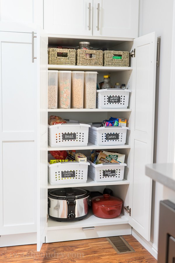 Baskets with chalkboard tape for easy pantry organization